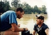Gold sampling-Dave McCracken consulting with sampling team