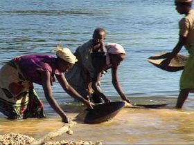 Locals Panning River Gravels-Africa